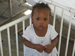 A young girl at the Little Children of Jesus Home, a home for handicapped children.... (this place is one of those places that tugs at your heart)