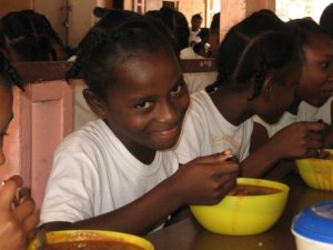 wow.. what else can I say. It was alot of fun to get the kids to smile. This is a young girl at the Maison D'Amor Girls Home during there lunch.